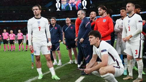 Grealish (L) watches on during the penalty shootout