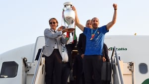 The Italy squad touched down on home soil early on Monday morning