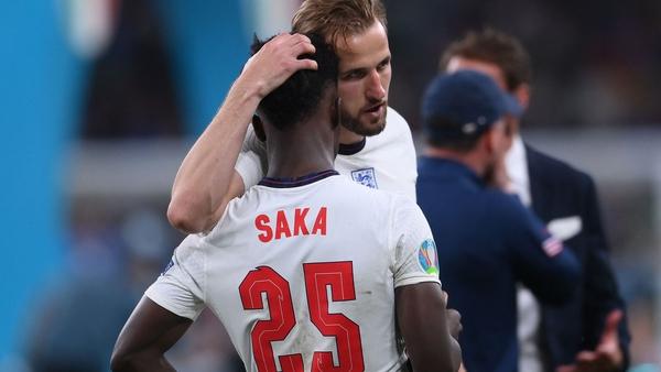 England captain Harry Kane consoles Bukayo Saka after the latter's penalty miss