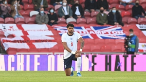 Tyrone Mings takes the knee ahead of England's pre-tournament game with Austria
