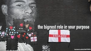 Locals left messages of support on the plastic that covers offensive graffiti on the mural of Marcus Rashford