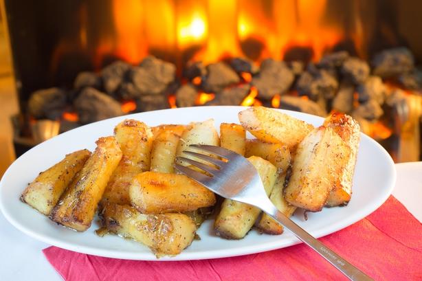 A dish of roast parsnips at Christmas (Alamy/PA)