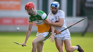 Tom Dooley and Cian Shanahan contest possession