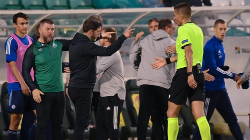 Stephen Bradley exchanges words with referee Mario Zebec at the full-time whistle