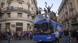 Thousands of euphoric fans thronged the centre of Rome on Monday afternoon to hail coach Roberto Mancini and his team after their triumph over England on penalties