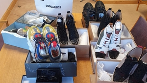 €4,500 in cash, designer shoes, sunglasses and clothing were recovered during the search