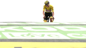 Tadej Pogacar crosses the finish line to extend his lead in the yellow jersey
