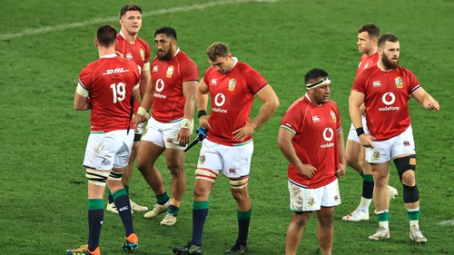 Lions players react at the full-time whistle