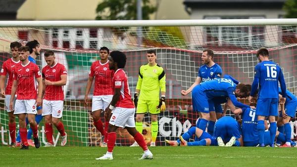 FH Hafnarfjordur's Steven Lennon (hidden) celebrates with team-mates after scoring his side's first goal
