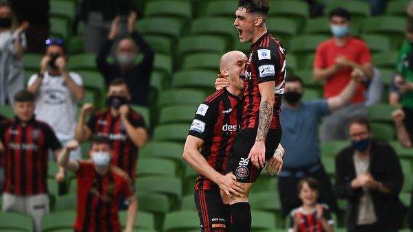 Georgie Kelly (L) celebrates with Dawson Devoy after scoring Bohemian's first goal
