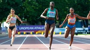 Rhasidat Adeleke (C) eased to victory in her 100m semi-final