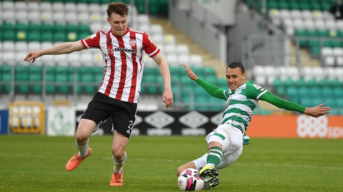 Graham Burke challenges Cameron McJannet during Shamrock Rovers' clash with Derry in May