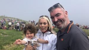 Máire Martha Ní Chathasaigh, David Lennon and their son Mac Dara enjoying the annual Féile Mhic Dara boat festival on Friday