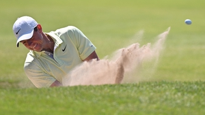 Rory McIlroy chips on to the seventh green at Royal St George's from the bunker