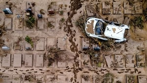 An aerial view taken with a drone shows a damaged car at a cemetery in Bad Neuenahr-Ahrweiler, Germany