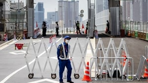 A security guard at the entrance to the Olympic Village in Tokyo