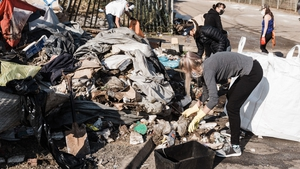 Locals clean-up debris left by looting and rioting on Queen Nandi Drive in Durban