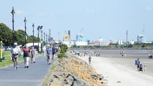 Walkers take a stroll along Sandymount Strand, Dublin