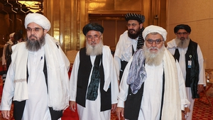 A delgation of Afghanistan's Taliban movement attends a session of the peace talks between the Afghan government and the Taliban in the Qatari capital Doha