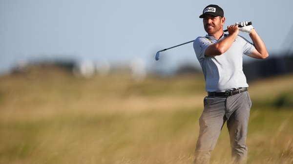 Louis Oosthuizen had a wobble on the back nine but recovered to maintain his lead