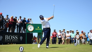 Shane Lowry hit two late birdies to keep him in with an outside chance of competing for the Claret Jug