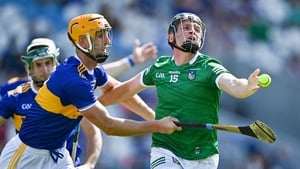 Peter Casey of Limerick is tackled by Barry Heffernan of Tipperary