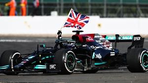 Lewis Hamilton celebrates his Silverstone success