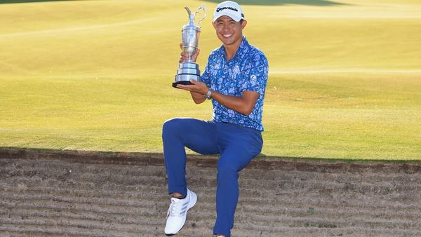 Collin Morikawa poses with the Claret Jug by the 18th green at Royal St George's
