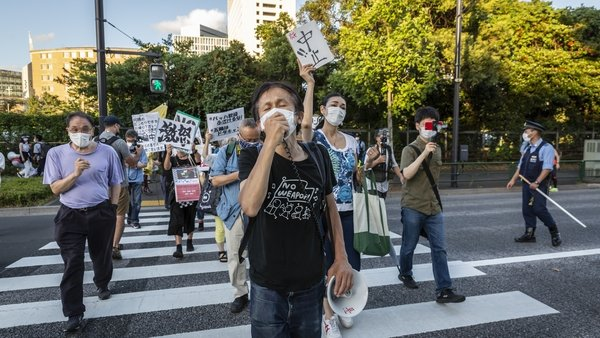 Protesters march during a demonstration