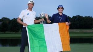 Seamus Power poses with the trophy and his caddie Simon Keelan