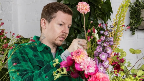 Having garnered praise from fans for sharing his vulnerabilities, Professor Green speaks to Liz Connor about normalising sending 'blooms to his bros'.