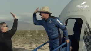 Jeff Bezos celebrates a successful first human flight for his Blue Origin company