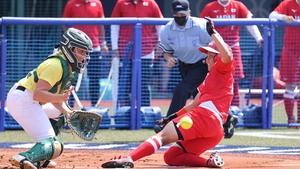 Japan's Minori Naito slides into the home plate