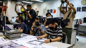 Lam Man-chung photographed in June proof reading the final edition of the Apple Daily