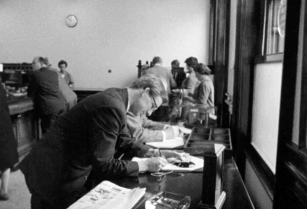 Lodgements and withdrawals being made in a bank following the 1966 bank strike