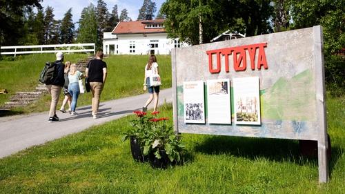 People walk on Utoya where Anders Behring Breivik killed 69 people in 2011