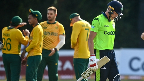Ireland's Harry Tector trudges off the field after being caught out by Quinton de Kock