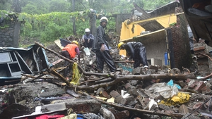 Workers clear debris after a landslide, at New Bharat Nagar in Mumbai earlier this week