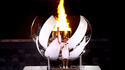 Naomi Osaka lights the Olympic cauldron with the Olympic torch