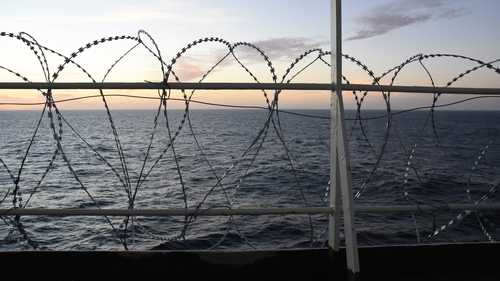 Barbed wire attached to a ship's railings to protect the crew against piracy attacks in the Gulf of Guinea