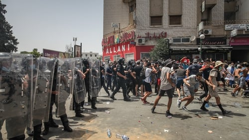 Police clashed with protesters in a number of cities across Tunisia