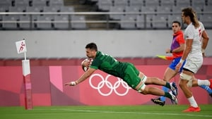 Harry McNulty of Ireland scores a try during the Pool C match against the USA