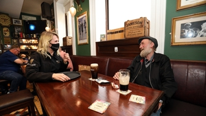 Jimmy Nooks from Capel Street is served a pint from Becky Roche in Slattery's pub in Dublin (Pic: RollingNews.ie)