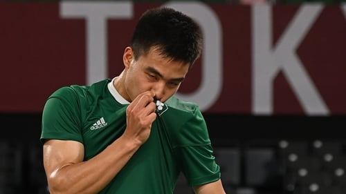 Nhat Nguyen kisses the Team Ireland logo after his victory