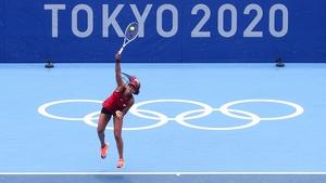 Naomi Osaka hammers down a serve in her win over Viktorija Golubic
