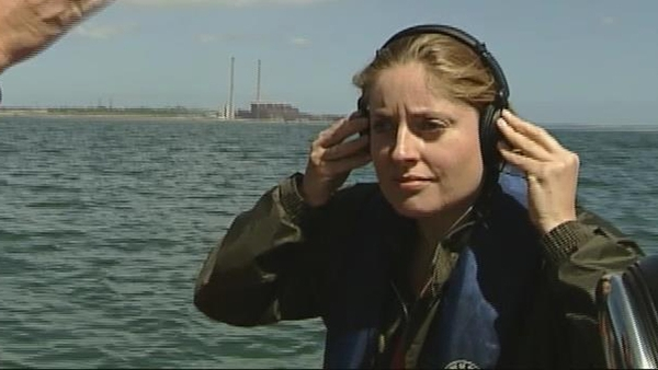 Reporter Emma O'Kelly listening to dolphins in the Shannon Estuary (2006)