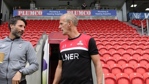 John Schofield (right) makes a permanent move from Championship club Peterborough