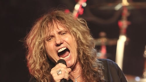 David Coverdale on stage during a concert appearance with Whitesnake on July 28, 2015. (Photo by John Atashian/Getty Images)