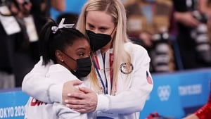Simone Biles is comforted by her coach