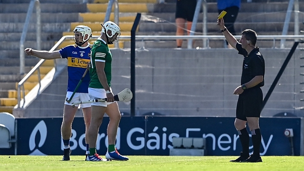 Aaron Gillane of Limerick is shown a yellow card by Paud O'Dwyer during the Munster final